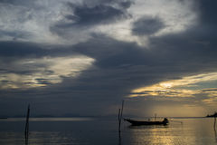 Alone Fishing boat. Fishing boat alone in the sea at sunset Royalty Free Stock Photos