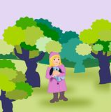 Alone in the Forest. A little girl, with a blue Stock Images