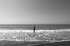 Alone girl looking at the sea Stock Photography