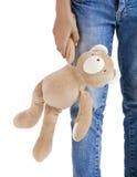 Alone with her teddy bear Stock Photos