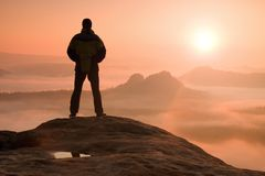 Free Alone Hiker Standing On Top Of A Mountain And Enjoying Sunrise Royalty Free Stock Photography - 55840377