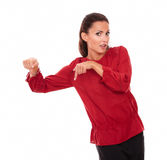 Alone hispanic woman pointing her finger down Stock Photos