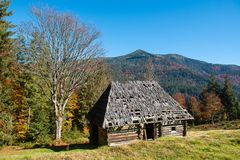 Alone house in autumn mountain stock photo