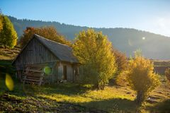 Alone house in autumn mountain royalty free stock photography