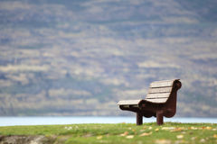 Alone. Lake side alone seat background Stock Photo