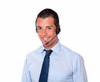 Alone latin man speaking with earphone Stock Photography