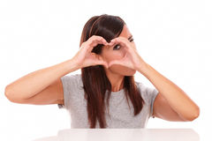 Alone latin woman looking through love sign Royalty Free Stock Photo