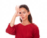 Alone latin woman with ok sign on her eye Royalty Free Stock Image