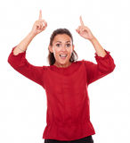 Alone latin woman pointing up her fingers Royalty Free Stock Photo