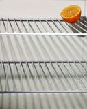 The only. Alone lemon in empty freezer Royalty Free Stock Photos