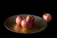Alone. Lonely red apple set apart from the others. Royalty Free Stock Photos