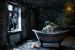 Alone  man in abandoned bathroom Royalty Free Stock Photography
