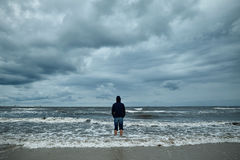 Alone man on the beach Stock Images