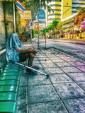 Alone man at busstation on thailand Royalty Free Stock Photo