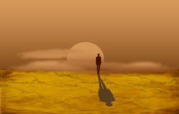 Alone man in the desert Royalty Free Stock Image