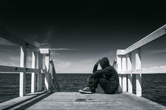 Alone Man at the Edge of Wooden Pier Stock Photography