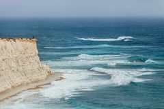 Alone man enjoying the strong surf on the cliff near the Marsaxl. Okk , Malta Royalty Free Stock Photography