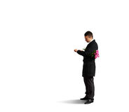 Alone man holding flowers. And looking at the watch. isolated on white background Royalty Free Stock Images