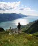 Alone man overview Lake Garda with Monte Baldo Royalty Free Stock Image