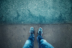 Alone man standing on blue grunge asphalt floor Royalty Free Stock Photos