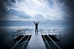 Alone man standing on the edge of pier in twilight royalty free stock photos