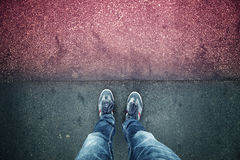 Alone man standing on red grunge asphalt floor Royalty Free Stock Photography