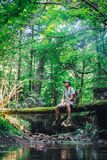 Alone man in wild forest. Travel and adventure concept. Landscape photography stock photos