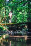 Alone man in wild forest. Travel and adventure concept. Landscape photography stock photography