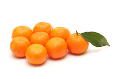 Alone mandarine with leaf in the crowd Royalty Free Stock Image