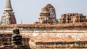 Alone in the middle of the ruin. Buddha in the middle of temple ruin in Ayutthaya, Thailand Stock Photo