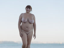 Alone naked woman on beach Stock Images