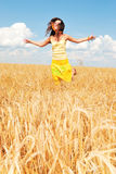 Alone with nature. Beautiful girl in a wheat field Stock Image