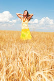 Alone with nature. Beautiful girl in a wheat field Royalty Free Stock Photo