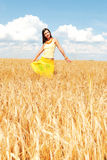 Alone with nature. Beautiful girl in a wheat field Stock Photos
