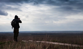 Alone nature Photographer shoots the landscape Royalty Free Stock Photography
