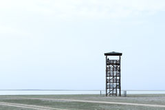 Alone observant. Tower and silhouette of man Royalty Free Stock Photos