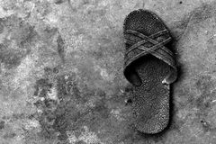 Alone old rubber shoe on dirty cement ground for background. Detail alone old rubber shoe on dirty cement ground for background Stock Images