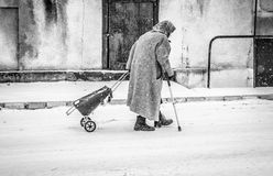 Alone. Old woman on empty streets on a cold day Royalty Free Stock Photography