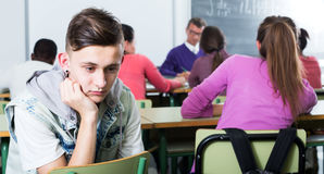 Alone outcasted student being mobbed by other students Stock Photo