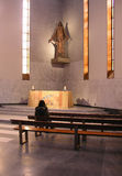Alone in prayer. Liverpool RC Cathedral, UK Stock Photos