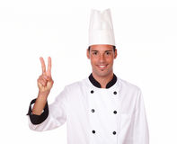 Alone professional chef with victory sign Royalty Free Stock Photo