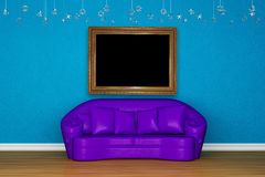 Alone purple sofa with picture frame Stock Photo