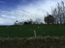 Alone. Raining, a few drop on the window Stock Image