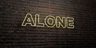 ALONE -Realistic Neon Sign on Brick Wall background - 3D rendered royalty free stock image Royalty Free Stock Image