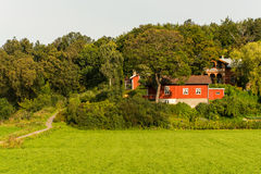 Alone red farmhouse on a meadow Stock Photography