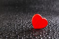 Alone red heart. Shape with water drop background Royalty Free Stock Images