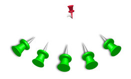 Alone red pin. Green pins attack a lonely small red pin Stock Images