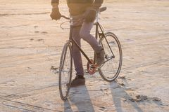 Adventure on fixed gear bicycle in desrt. Alone rider on fixed gear road bike riding in the desert near river, hipster tourist bicycle rider pictures Stock Photography