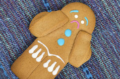 Alone and sad gingerbread man cookie on a table Royalty Free Stock Photography