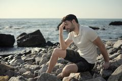 Free Alone Sad Man Sitting On A Sea Beach Stock Image - 150335561